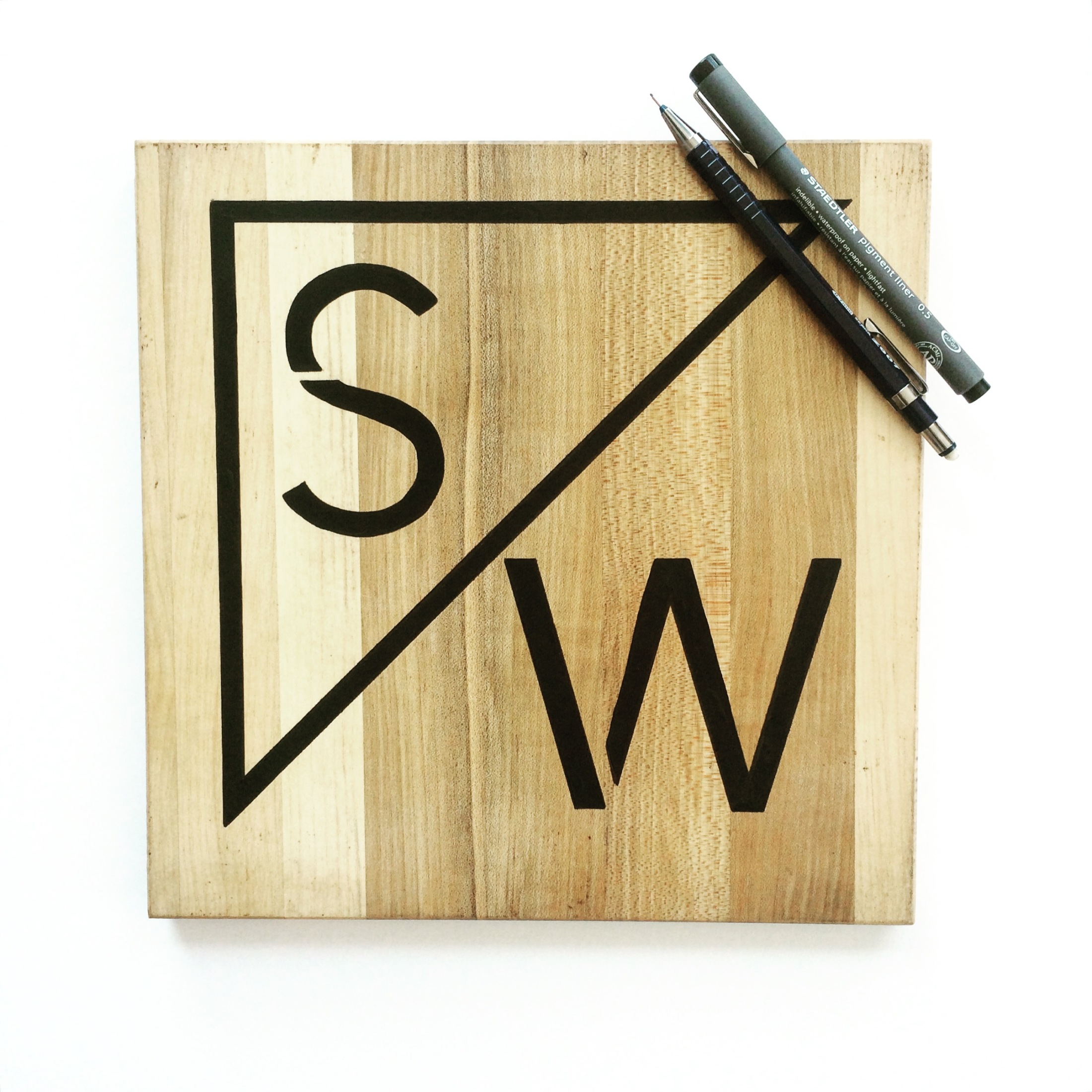 Hand drawn S and W iconography for Stray and Wander