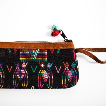 Up cycled traditional Guatemalan textile finished with leather trim clutch