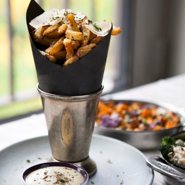 Truffles fries on a bed with aioli on the site