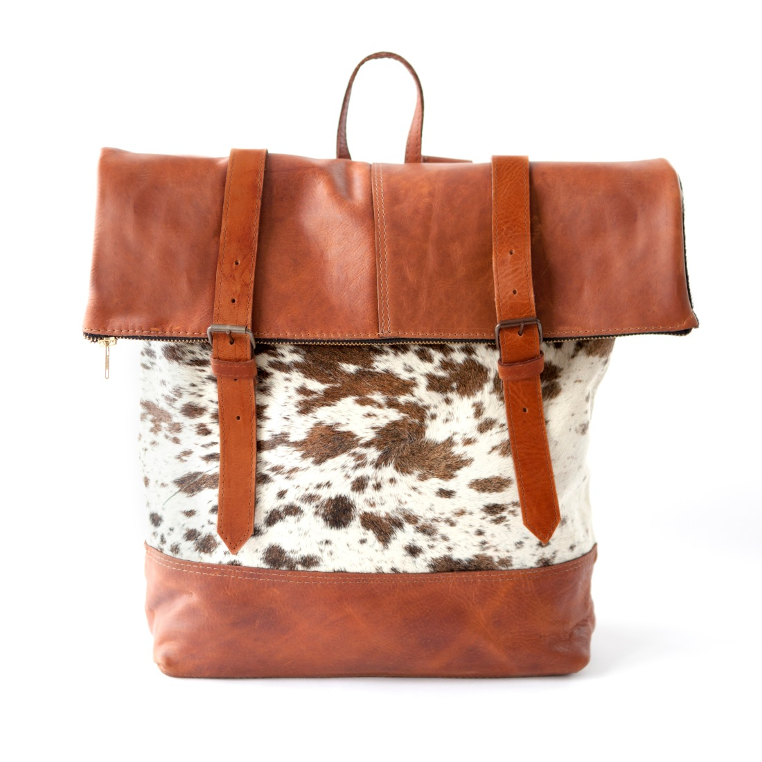oversized cow fur with tan leather back pack
