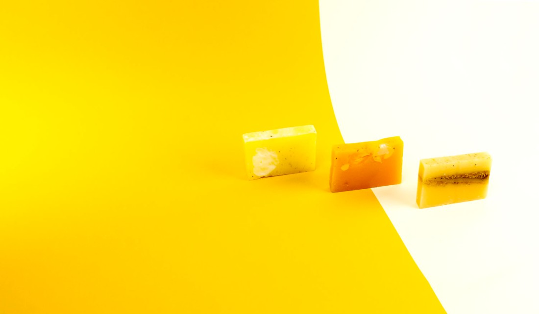 Sudsatorium yellow coloured soap bars on yellow background