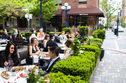 A full patio at the Hazelton Hotel