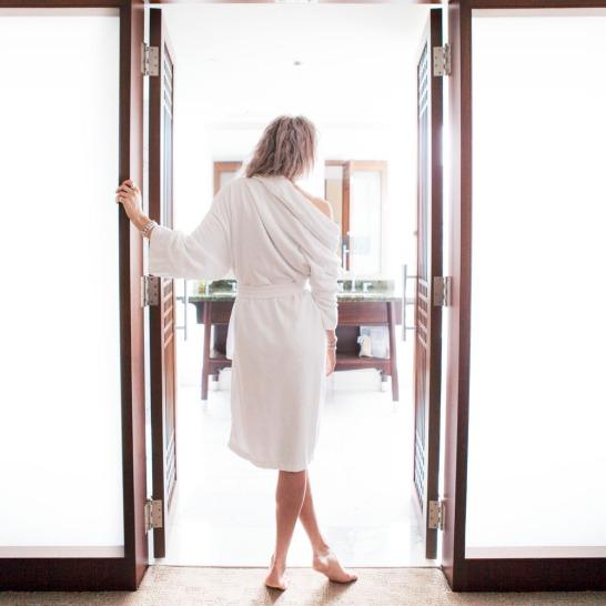 Female standing in front of the bathroom door