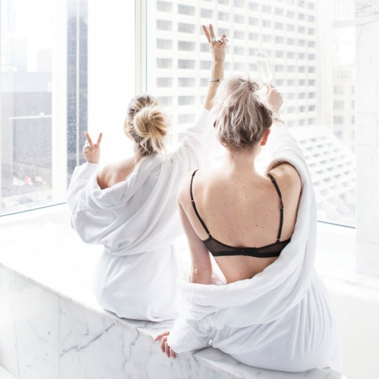 Two females in robes overlooking the city