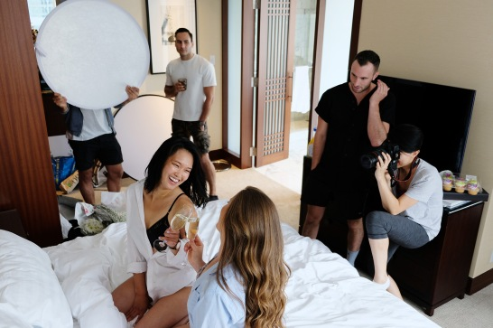 models are laughing while photographer shoots