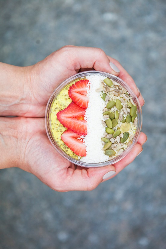 Hand holding a smoothie bowl