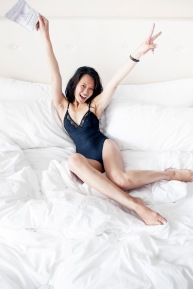 female on bed partying
