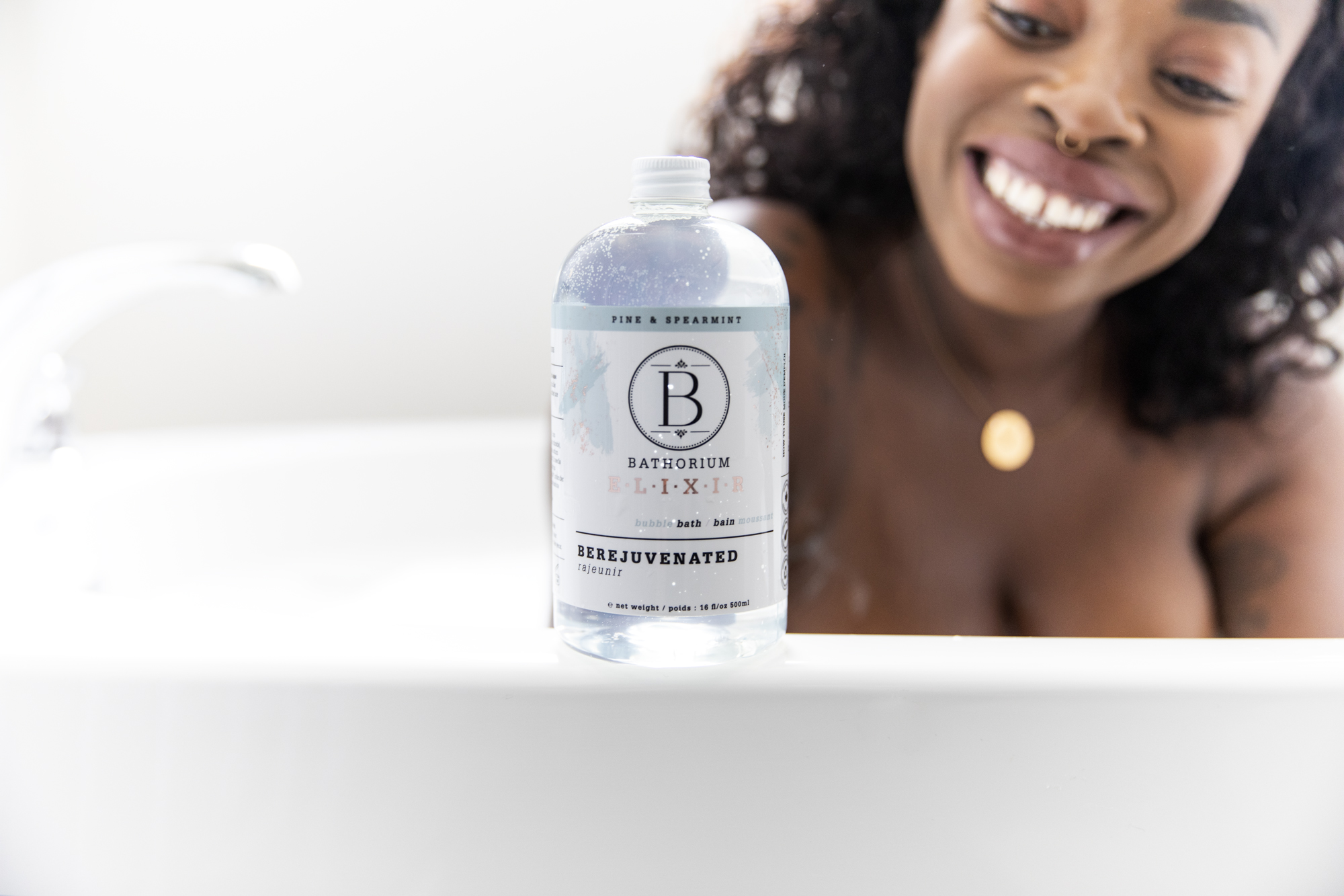 Bathorium BeRejuvenated Bubble bath on the ledge of the tub