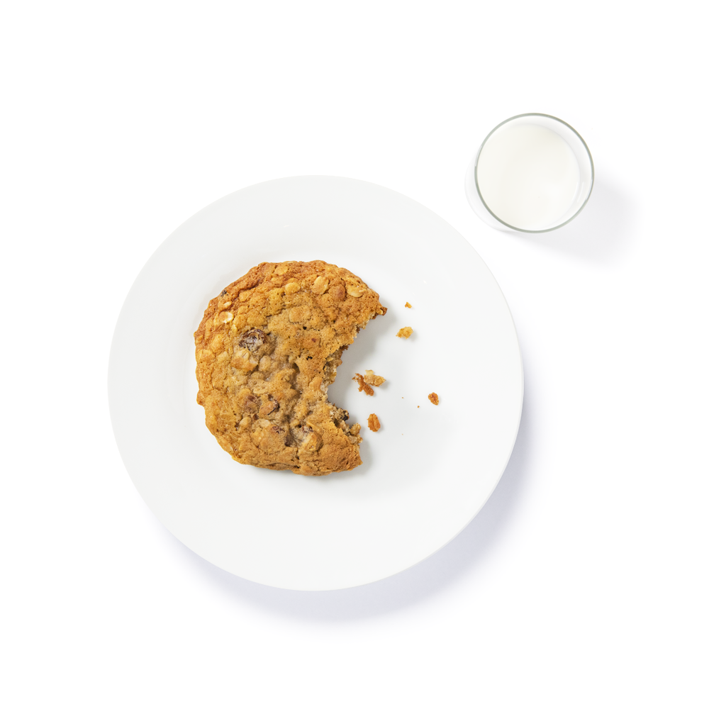 Oatmeal raisin cookie with a glass of milk