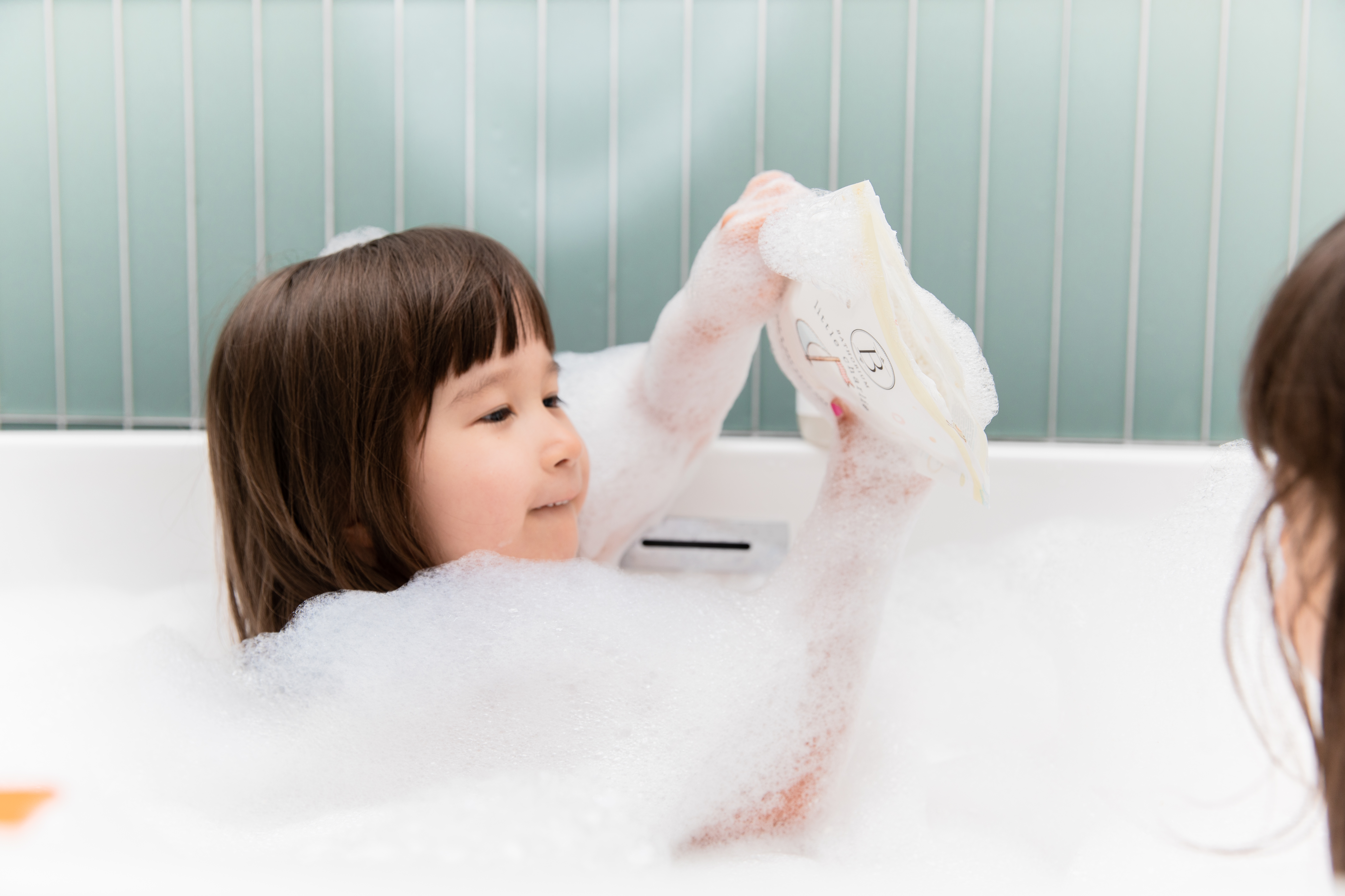 A little girl playing with Little Charlie Bath Soak