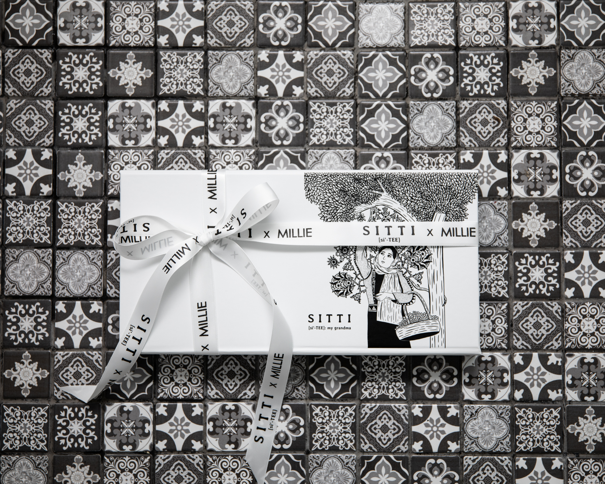 Sitti x Millie product packaging on a mosaic background